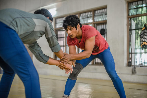 """Neetu trains nearly eight hours a day at a wrestling facility in Rohtak, India. Her coach says, """"She doesn't take a break for even one minute."""""""