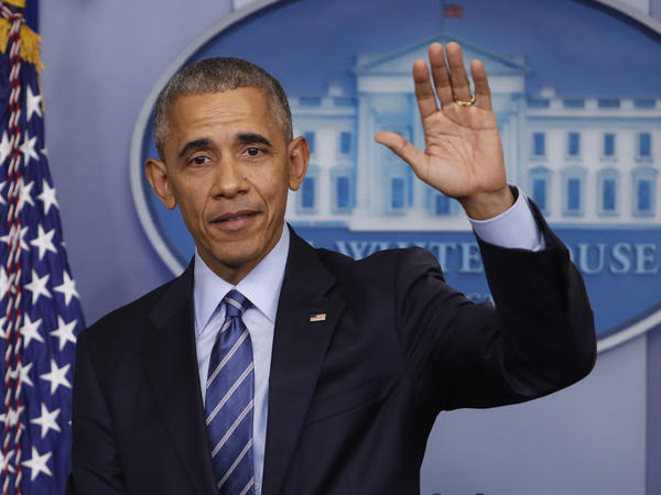 President Obama waves at the conclusion of his news conference in the briefing room of the White House on Dec. 16.