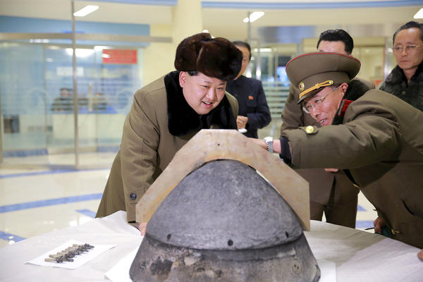 North Korean leader Kim Jong Un looks at a warhead component being developed for a ballistic missile, at an unidentified location in this undated photo released by North Korea's Korean Central News Agency on March 15, 2016.