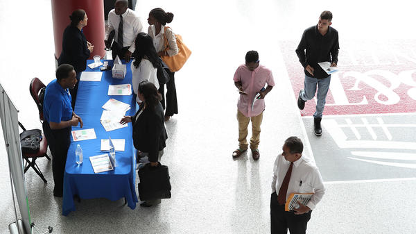 People attend the JobNewsUSA job fair at the BB&T Center on Nov. 15 in Sunrise, Fla.