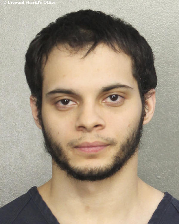 This booking photo provided by the Broward Sheriff's Office shows suspect Esteban Ruiz Santiago, 26, on Saturday.