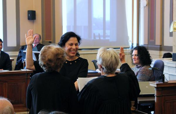 Judge Marilyn Zayas is sworn in by Judge Beth Myers (right) as her mother stands by her side.