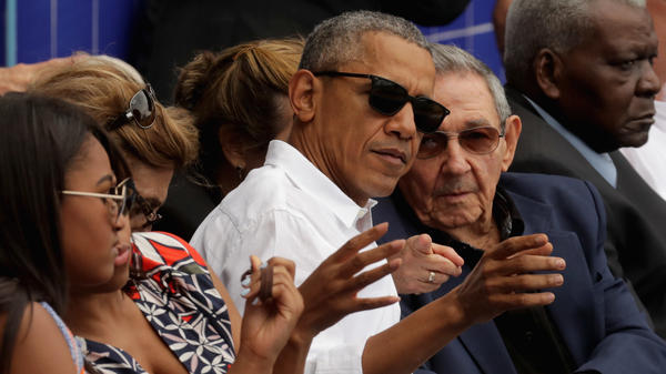 President Obama and Cuban President Raul Castro visit during an exhibition game between the Cuban national team and Major League Baseball's Tampa Bay Rays at the Estado Latinoamericano in Havana, Cuba, in March 2016.