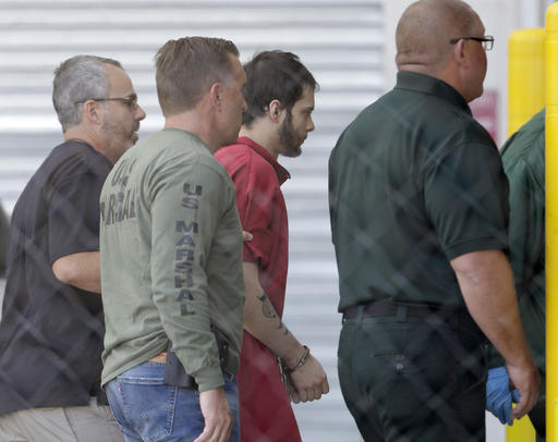 Esteban Santiago, third from left, accused of fatally shooting several people and wounding multiple others at a crowded Florida airport baggage claim, is returned to Broward County's main jail after his first court appearance.