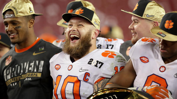 Clemson Tigers linebacker Ben Boulware, center, celebrates after his team defeated the Alabama Crimson Tide 35-31 to win the 2017 College Football Playoff National Championship Game.