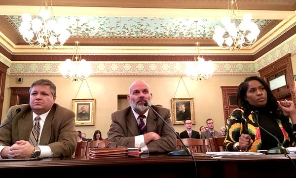 Lobbyists Matt Jones, left, and Peter Baroni testify before a House committee with Rep. Jehan Gordon-Booth.