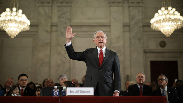 Republican Sen. Jeff Sessions of Alabama is sworn in Monday for his confirmation hearing by the Senate Judiciary Committee.