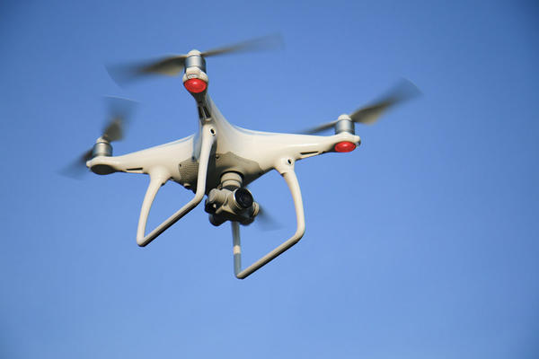 Legislation in Washington state could set privacy rules for hobbyists flying drones such as this DJI Phantom drone over private property.
