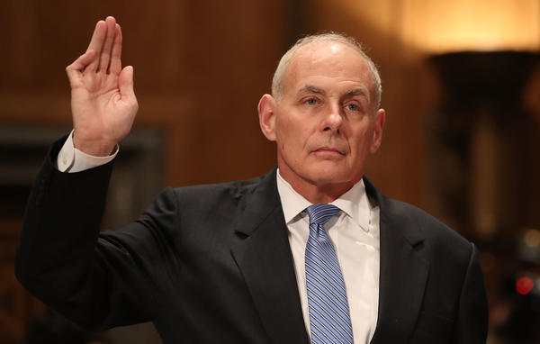 Retired Marine Gen. John Kelly is sworn in before his confirmation hearing in front of the Senate Homeland Security and Governmental Affairs Committee to run the Department of Homeland Security on Tuesday.