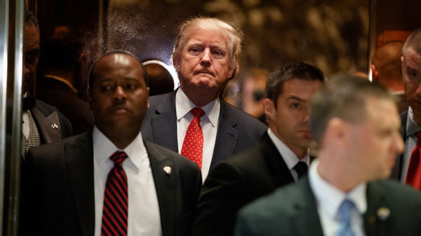 President-elect Donald Trump gets on an elevator Monday after speaking with reporters at Trump Tower in New York.