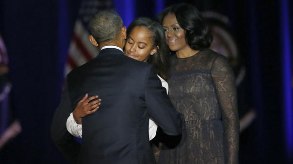President Barack Obama is joined by his daughter Malia and First Lady Michelle Obama after giving his presidential farewell address at McCormick Place in Chicago, Tuesday, Jan. 10, 2017.