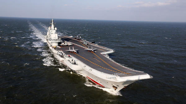 The Liaoning, China's only aircraft carrier, sails during military drills in the Pacific on Dec. 24. Taiwan's defense minister warned on Dec. 27 that enemy threats were growing daily after China's aircraft carrier and a flotilla of other warships passed south of the island in an exercise. On Wednesday, the carrier traveled through the Taiwan Strait.