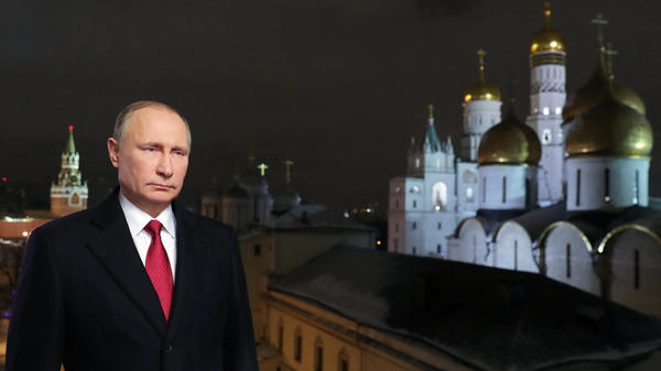 Russian President Vladimir Putin is shown at the Kremlin in Moscow during the recording of his recent New Year's message. Putin's spokesman said Wednesday that the Russian government does not gather compromising material, or <em>kompromat,</em> on political rivals, despite a well-documented history of such behavior.