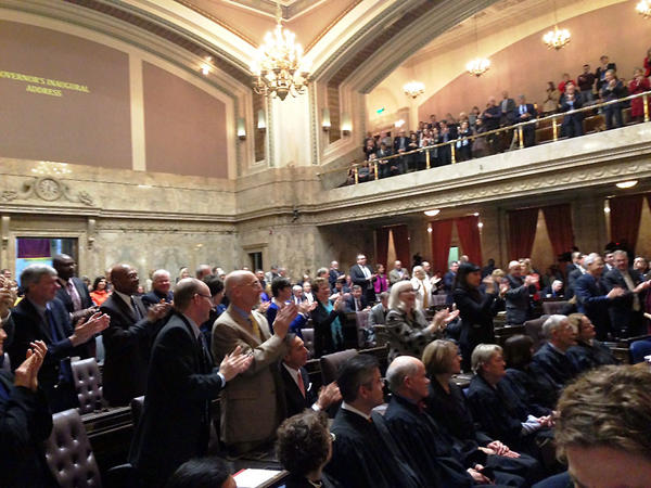 Democrats give Gov. Jay Inslee a standing ovation during his second inaugural address before a joint session of the Washington Legislature.