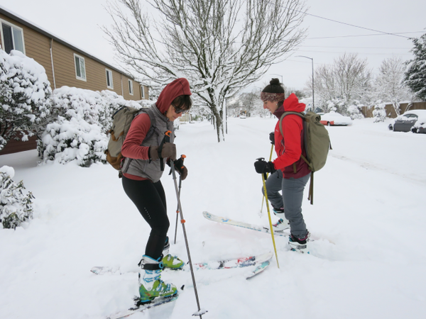<p>Sami Christensen (left) and Maddee Rubenson made their way down Northeast Dekum Street in Portland in skis on Wednesday, Jan. 11, 2017.</p>