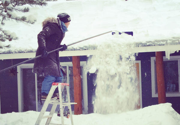 <p>Raking snow off the roof in Bend.</p>