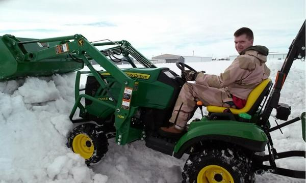 <p>In Ontario, Oregon, Rob Haun helps plow a path to his business.</p>