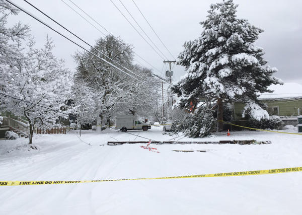 <p>Safety tape marks off a downed power line in SE Portland, Jan. 11, 2017.</p>