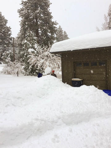 <p>The snow piles high in Bend where a man shovels his driveway. </p>