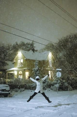 <p>Willow McCormick celebrates the snowstorm.</p>