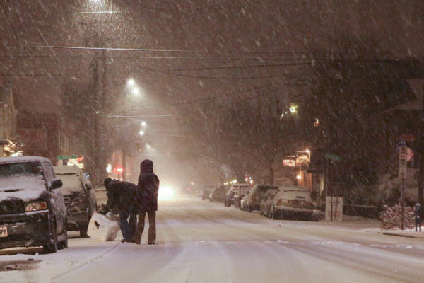 <p>People roll a giant snowball across Southeast 13th Avenue in Portland's Sellwood neighborhood on Tuesday, Jan. 10, 2017.</p>