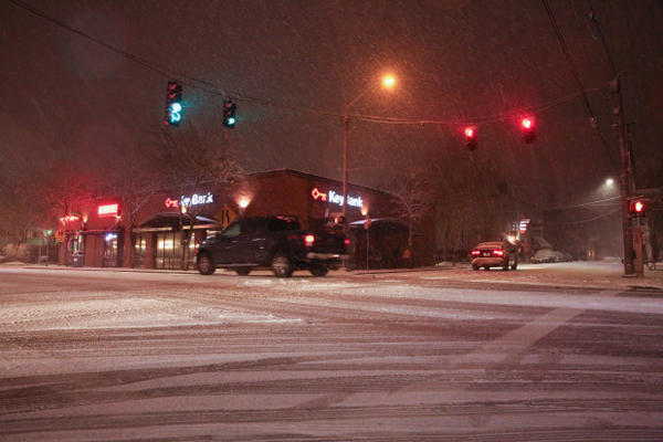 <p>Cars drive through the intersection of Southeast 13th and Tacoma in Portland's Sellwood neighborhood during a snow storm on Tuesday, Jan. 10, 2017.</p>