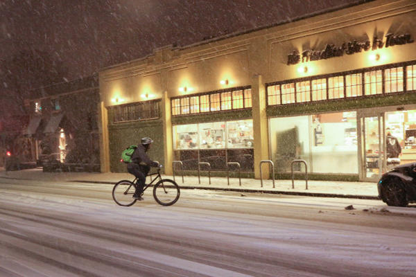 <p>A bicyclist pulls into a New Seasons grocery store on Tacoma Street in Portland's Sellwood neighborhood during a snow storm on Tuesday, Jan. 10, 2017.</p>