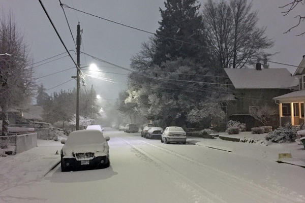 <p>Snow blanketed Portland streets, such as this one in the northeast part of the city, on Tuesday, Jan. 11, 2017.</p>