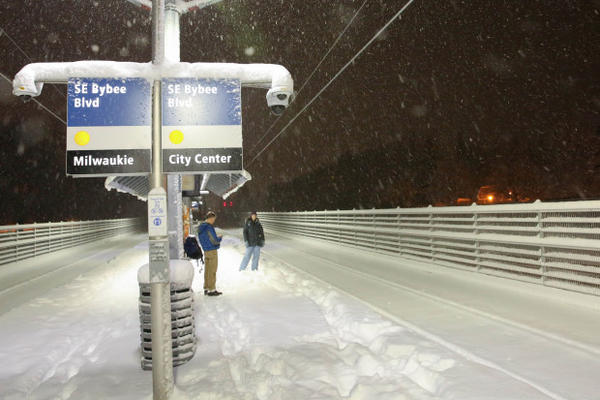 <p>People wait for an Orange Line MAX train at the Southeast Bybee Boulevard station in Portland's Sellwood neighborhood during a snow storm on Wednesday, Jan. 11, 2017.</p>