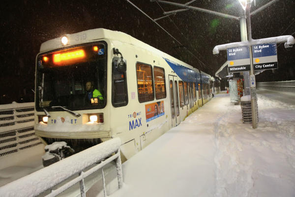 <p>An Orange Line MAX train departs the Southeast Bybee Boulevard station toward Milwaukie in Portland's Sellwood neighborhood during a snow storm on Wednesday, Jan. 11, 2017.</p>