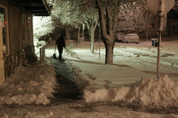 <p>A man shovels the walk outside Northwest Primary Care on Milwaukie Avenue in Portland's Sellwood neighborhood during a snow storm on Wednesday, Jan. 11, 2017.</p>
