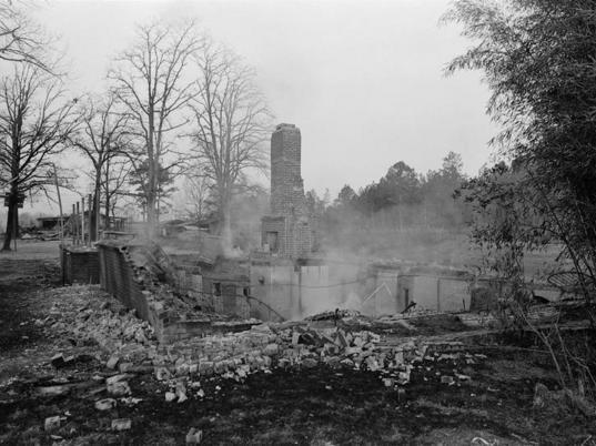 Smoking ruins of Vernon Dahmer's house in the Kelly Settlement of Hattiesburg, Miss., the morning it was firebombed on Jan. 10, 1966.