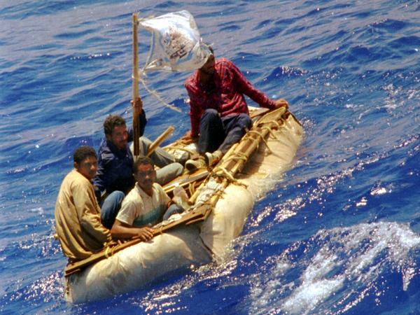 Cuban refugees float in heavy seas 60 miles south of Key West, Fla., in 1994. The Obama administration is ending a two-decades-old policy of allowing Cuban refugees to stay in the U.S. if they can make it to U.S. soil.
