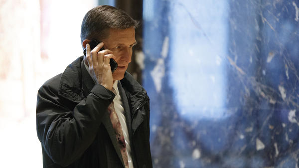 National Security Adviser nominee Michael Flynn walks in the lobby of Trump Tower in New York.