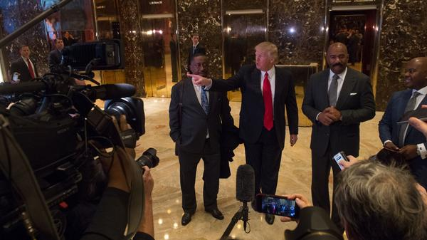 Greg Calhoun, President-elect Donald Trump and Steve Harvey speak with the media Friday at Trump Tower in New York.