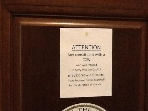 A flier on Rep. Nick Marshall's Capitol office door offering to let constituents borrow his firearm while visiting.