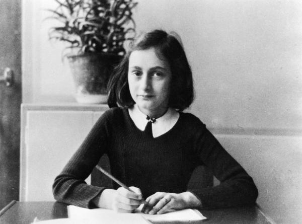 Anne Frank doing her homework in 1941.
