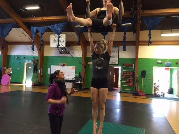As Ringling Bros. announces it will close, New England Center for Circus Arts in Brattleboro is keeping the art of circus performing alive. The group's co-founder Elsie Smith (left) works with Cherie Jacque and Miranda Kent on the trapeze.