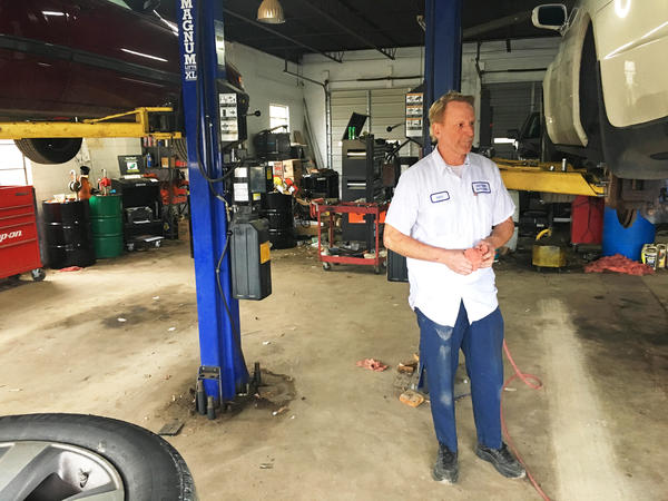 """Anthony """"Inky"""" Smith has owned East Bend Auto Clinic and Tire in the town of East Bend, N.C., for 30 years. He says friends who used to make $30 or $40 an hour in manufacturing now earn minimum wage and struggle to make ends meet."""