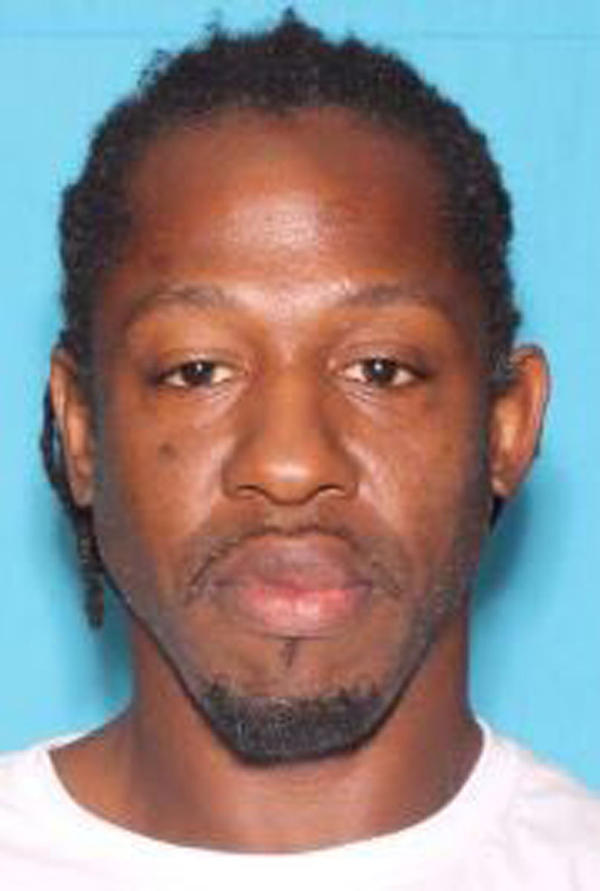 This undated photo provided by the Orlando Police Department shows Markeith Loyd, a suspect in the fatal shooting of an Orlando police officer earlier this month as well as a 24-year-old woman who was three months pregnant.
