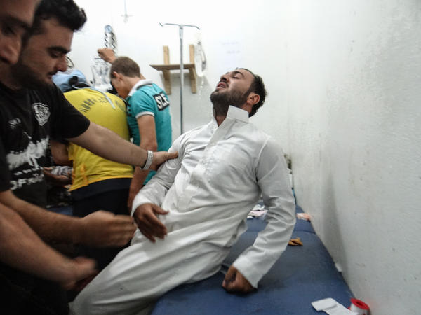 Health workers treat a man at a hospital in Idlib, Syria, about 40 miles from Aleppo.