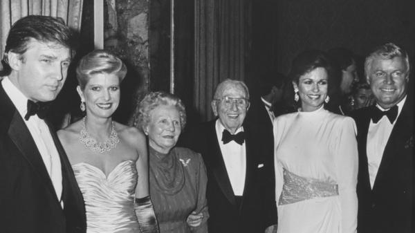 Businessman Donald Trump and wife Ivana with author Norman Vincent Peale and his wife, Ruth Peale, Phyllis George and Gov. John Brown at Peale's birthday party at the Waldorf Hotel in New York City in 1988.
