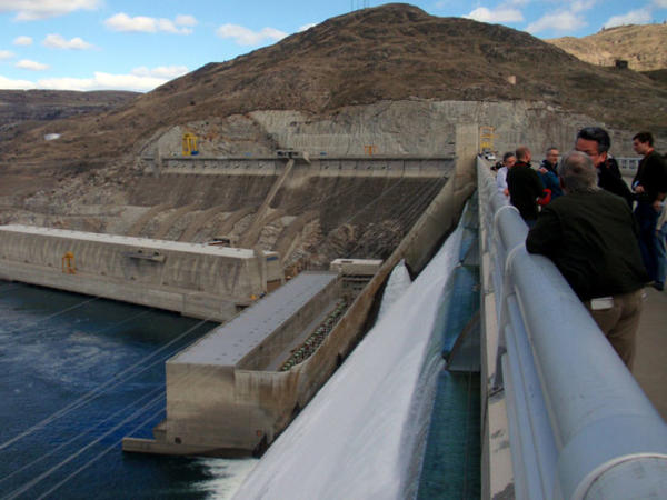 <p>File photo of a group touring  Grand Coulee Dam. Tribes and power planners are considering restoring salmon to the Upper Columbia Basin above the dam.</p>