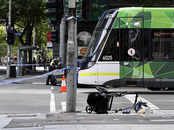 A stroller lies overturned on a street in the central business district of Melbourne, Australia, on Friday. A man deliberately drove into a street crowded with pedestrians, police said. Officials said the incident had no links to terrorism.