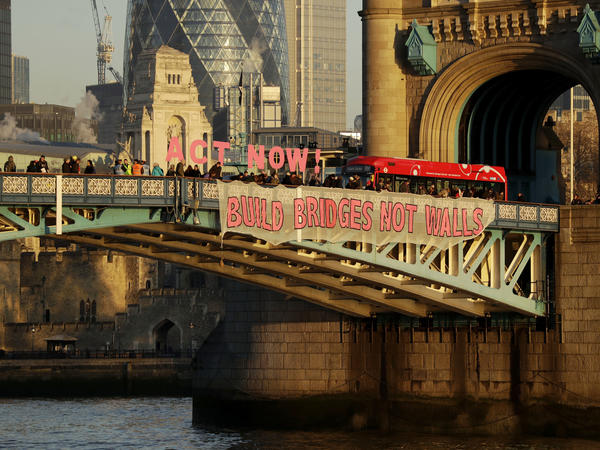 """Build Bridges Not Walls,"" reads a banner held by demonstrators on London's Tower Bridge to protest Donald Trump's inauguration as U.S. president on Friday."