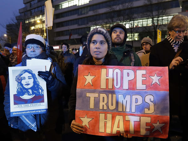 Protesters attend an anti-Trump demonstration in front of the headquarters of the Alternative for Germany, a far-right party in Berlin, on Friday.