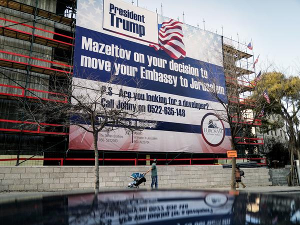 On a building under construction in Jerusalem, a banner bears a message of congratulations for Trump, along with an offer of work.