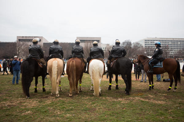 Police on horses surveyed the grounds as spectators gathered before the start of the inauguration events.