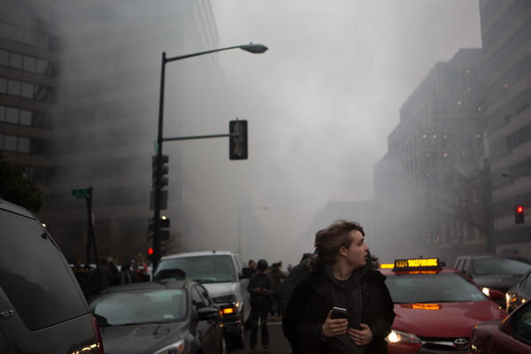 People run from smoke and fire that billows from near Franklin Square, where a limo was set on fire.
