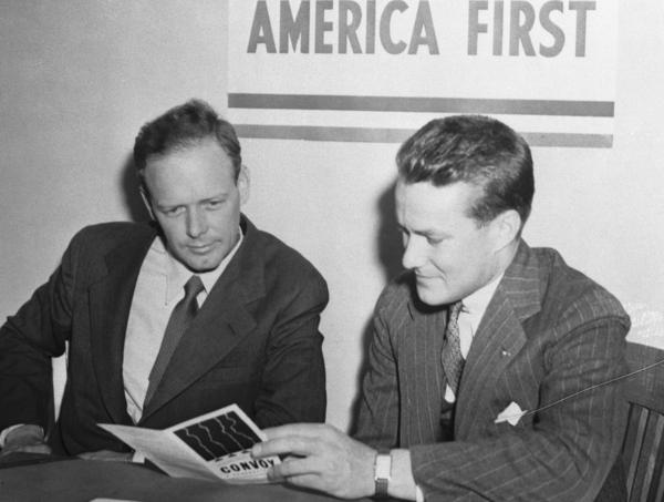Col. Charles A. Lindbergh (left) with R. Douglas Stuart, Jr., National Director of the America First Committee, when the aviator enrolled in Chicago as a member of the AFC.